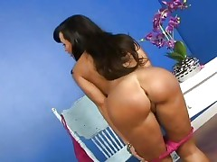 Nice-looking Lisa Ann shows off her succulent round arse