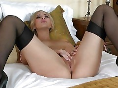 Pretty Sophia Knight torments her wet soaked pussy