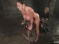 Christina Carter is a well known pornstar. The brown haired diva has a gorgeous body with massive tits and a sweet round ass. Being tied up on that table, that babe stands powerless, as that old man comes and attaches things to her pussy. While being machine fucked, a pantyhose is spreading water all over her pussy.