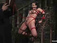 Mia Bangg is bound and gagged in the dungeon where her torturer sprays her nipple-clamped tits. He asks if she wishes to get fucked and she does, but first he gives her a little greater amount pain by pulling tight the rope that splits her cookie lips and smacks her cookie before using a dildo on her.