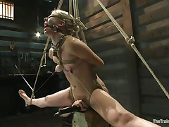 Chastity Lynn is a blonde milf who enjoys being fastened up with ropes. She likes when that babe is not able to move her hands and feet freely. As that babe stands helpless with a ball gag in her face hole and a rope blindfold on her eyes, a friend is giving her a large time pleasure, rubbing her cunt with a vibrator.