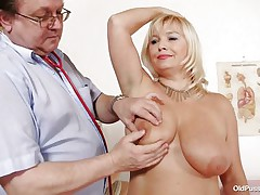 This blonde floozy is completely naked at the doctor. The doctor begins examining her big breasts with big and hawt nipples. After that that guy takes her pulse. The mature women is sitting on the bed now with her big a-hole at the doctor. That guy start inspects her a-hole and big shaved vagina from behind.