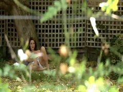 Voyeur masturbation of hairy cunt underneath a tree