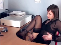 Brunette hair masturbates in sheer nylons and heels